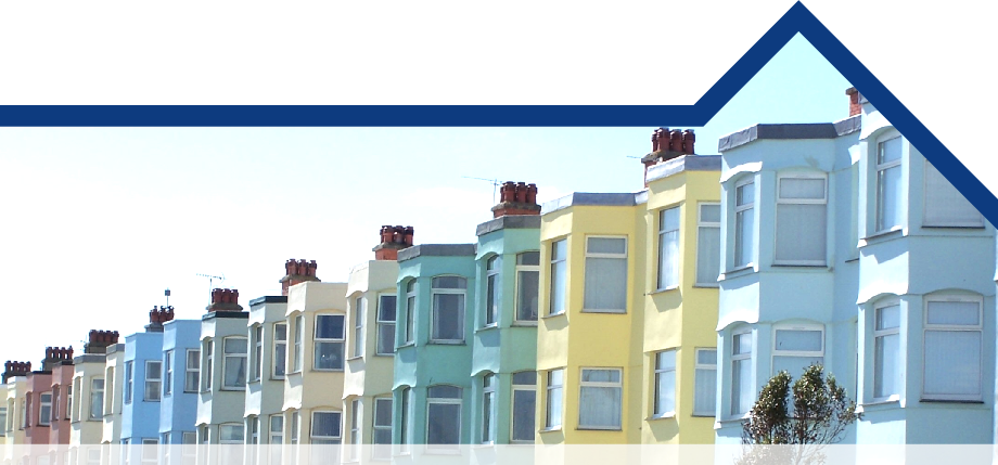 Image of a row of colourful terrace houses.